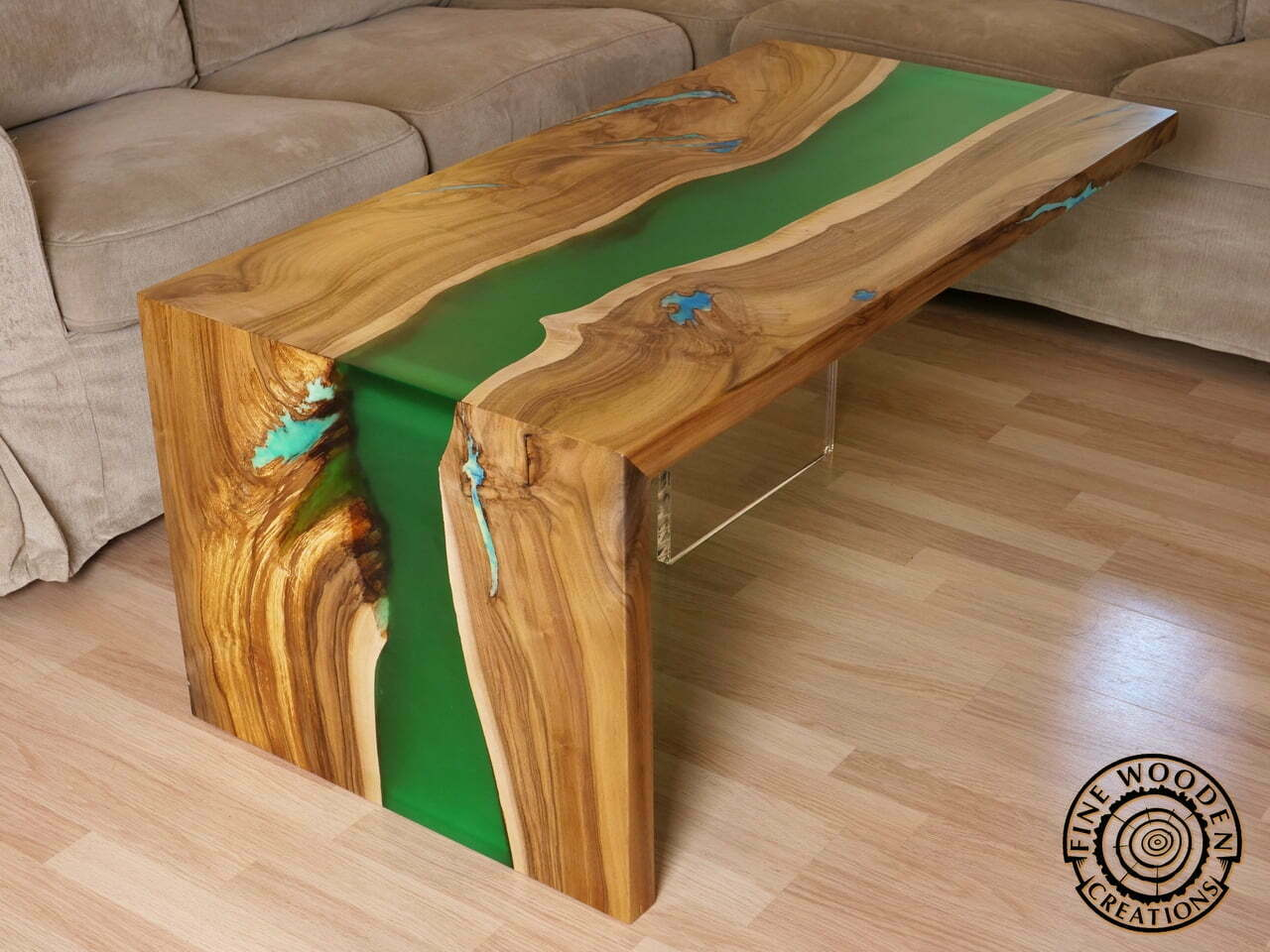 Waterfall Table Made Of Walnut With Green River Like Resin Part Flowing Through The Top And Falling Down Along One Legs